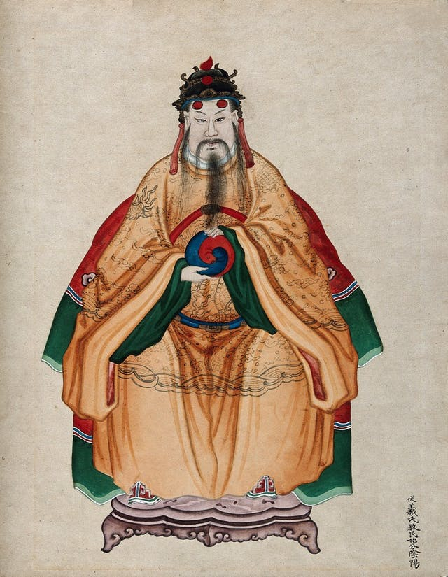 Image of a Chinese painting of an Emperor with a dark moustache and beard. He wears an orange cloak and is holding a yin yang circle.
