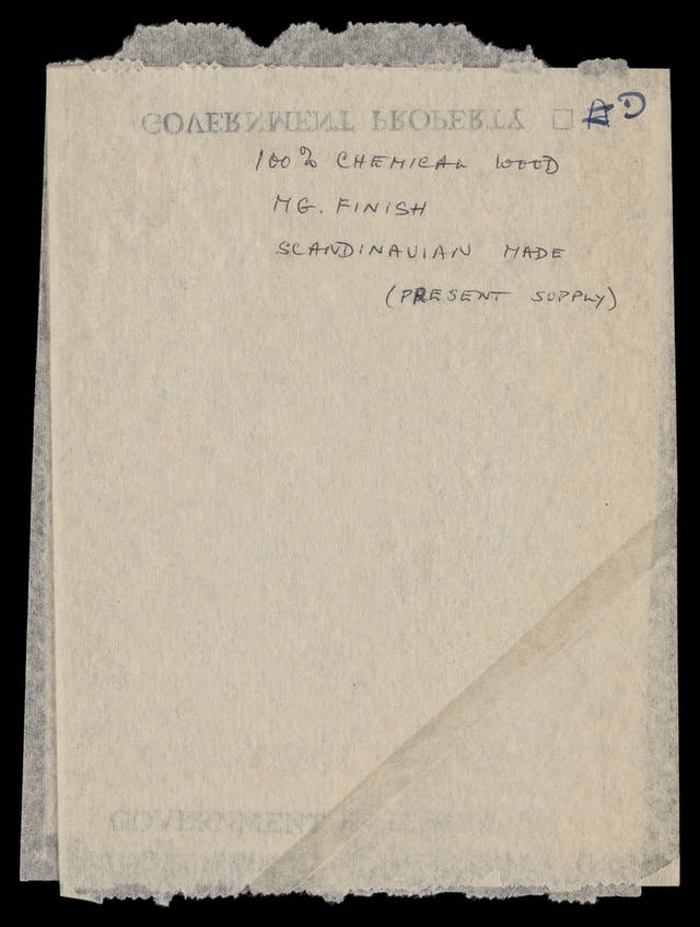 "Photograph of a toilet paper sample sheet, bearing the hand written words ""100% chemical wood, MG. Finish, Scandinavian made (present made)""."