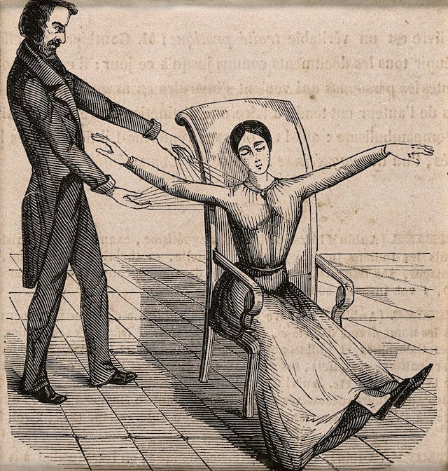 Image of a Mesmerist using Animal Magnetism on a female patient