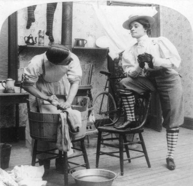 The new woman watches a man doing the laundry