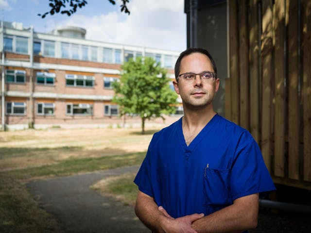 Photographic portrait of consultant anaesthetist, Ben Silverman outside Harefield Hospital.