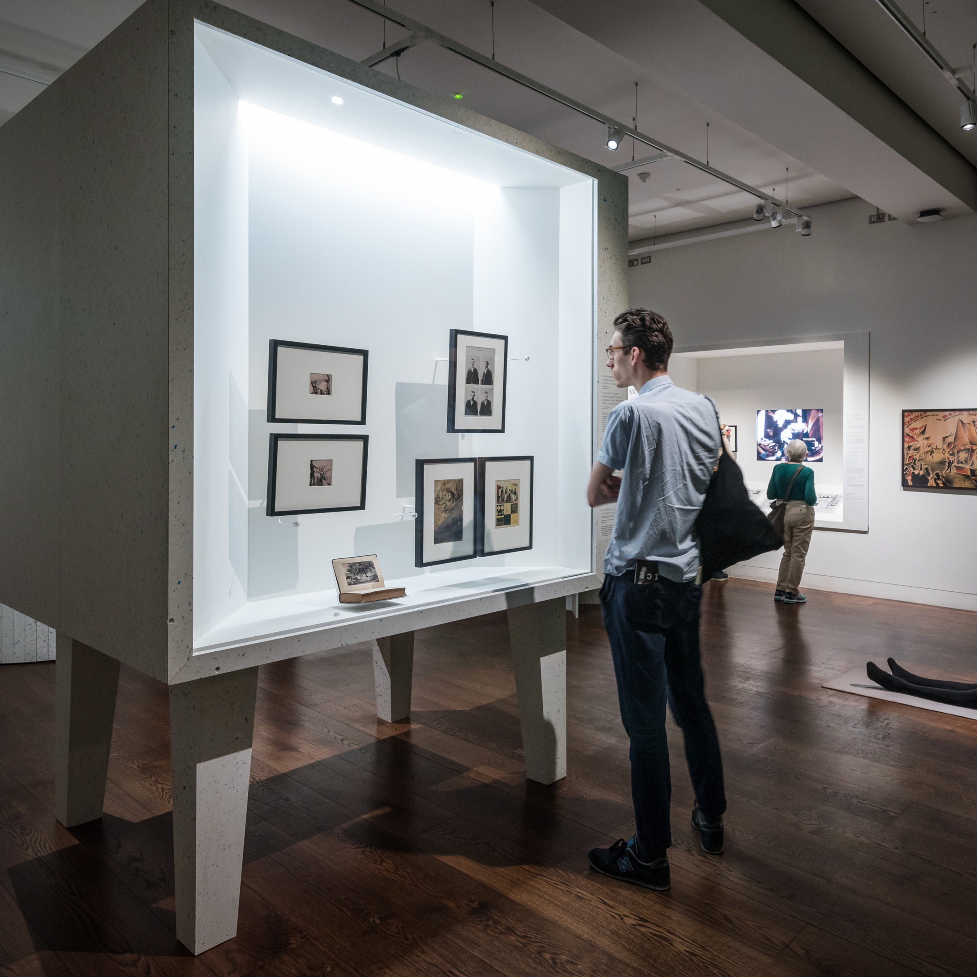 Photograph of visitors exploring the exhibition, States of Mind: Tracing the Edges of Consciousness at Wellcome Collection.