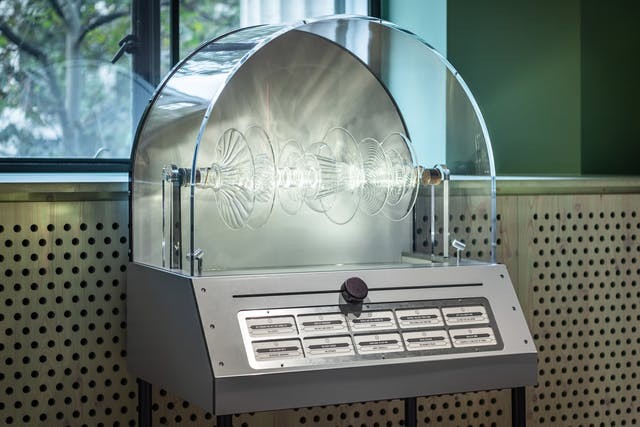 Photograph of an exhibit in a gallery space of an artwork which resembles a juke box.