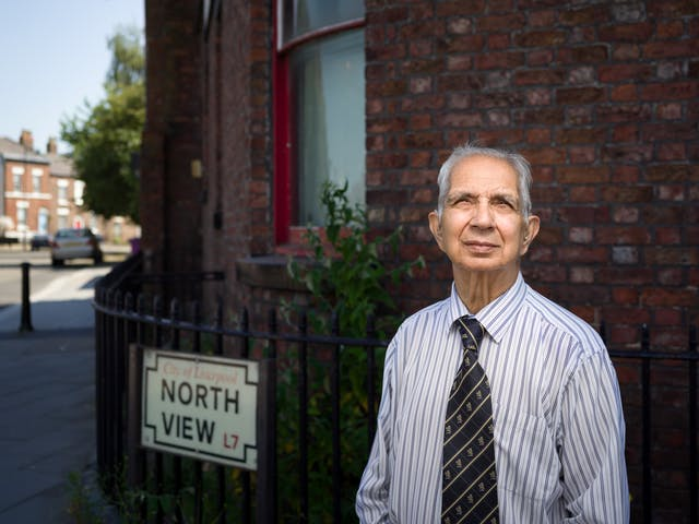 Photographic portrait of Dr Shiv Pande outside his former GP surgery.
