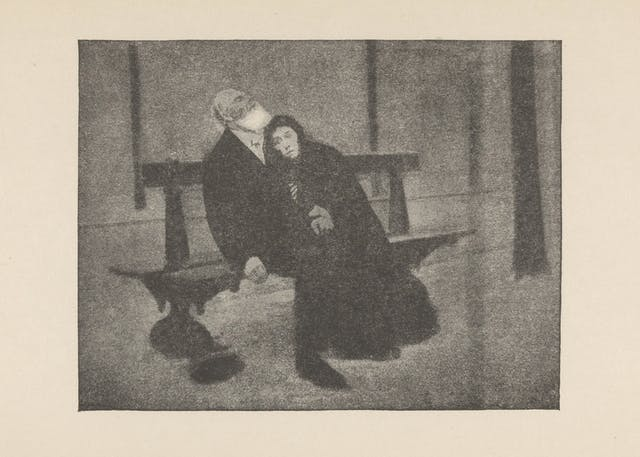 Black and white image of a man and woman sitting on a bench. The woman is leaning into the man.
