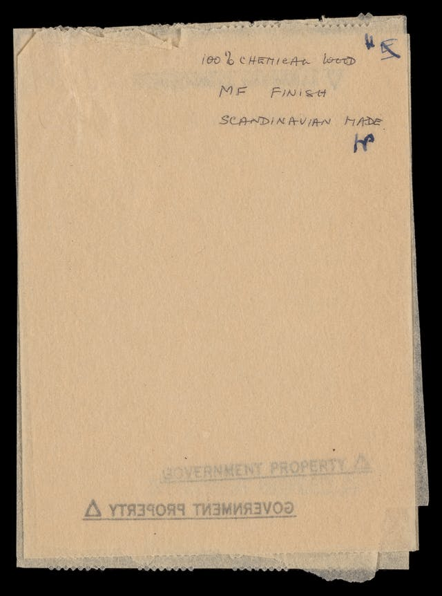 "Photograph of a toilet paper sample sheet, bearing the hand written words ""100% chemical wood, MG. Finish, Scandinavian made""."