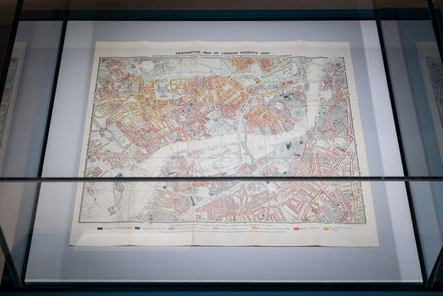 Photograph of an exhibition display case showing a Charles Booth map of poverty in London in 1889, as part of the exhibition living with Buildings at Wellcome Collection.
