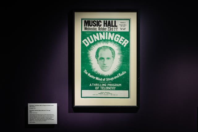 Photograph of a framed poster for the performance titled