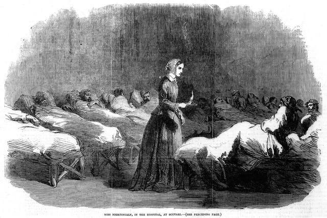 A black and white wood engraving of Florence Nightingale, surrounded by patients in hospital beds.