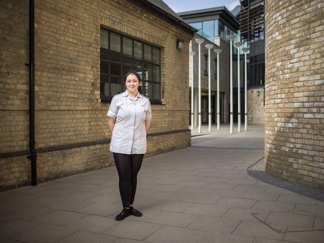 Photographic full length portrait of Jenny Jones, a student nurse, at Anglia Ruskin University, Cambridge.