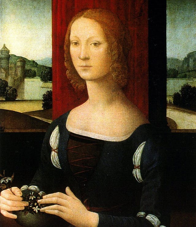 Oil painting of young European noblewoman Caterina Sforza (c.1463-1509) seated infront of a window with an Italian landscape. Artist Lorenzo di Credi