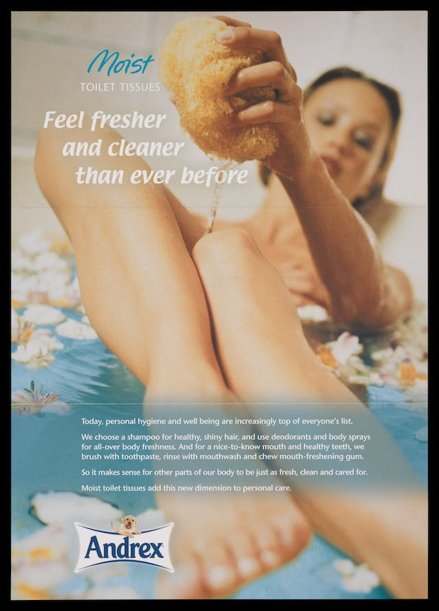 "Photograph of the cover of a promotional leaflet for Andrex toilet tissue showing a woman in the bath squeezing water from a sponge over her legs, with the title, ""Feel fresh and cleaner than ever before""."
