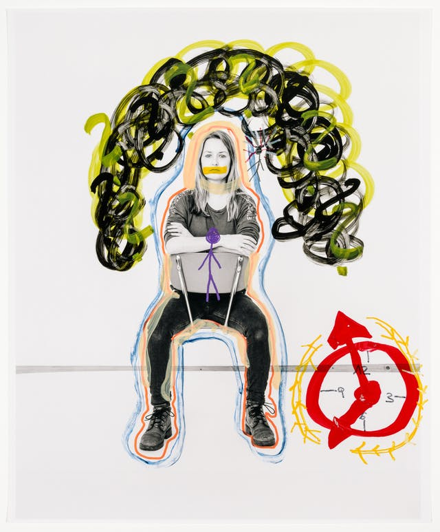 Full body photograph of a blonde woman sitting backwards on a chair, with her arms folded over the backrest. Around the photograph are hand-drawn images in colourful marker pens.  Above the lady are a series of ominous yellow and black clouds.  Outlining her body are two red and blue strokes. In front of her body is a purple stick figure.  To the bottom left of the frame is a red clock with a series of yellow arrows formed in a clockwise direction.  The woman's face has a yellow mark over her mouth as she stares into the camera.
