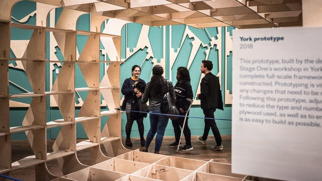 Photograph of a group of people exploring the Global Clinic exhibition at Wellcome Collection.
