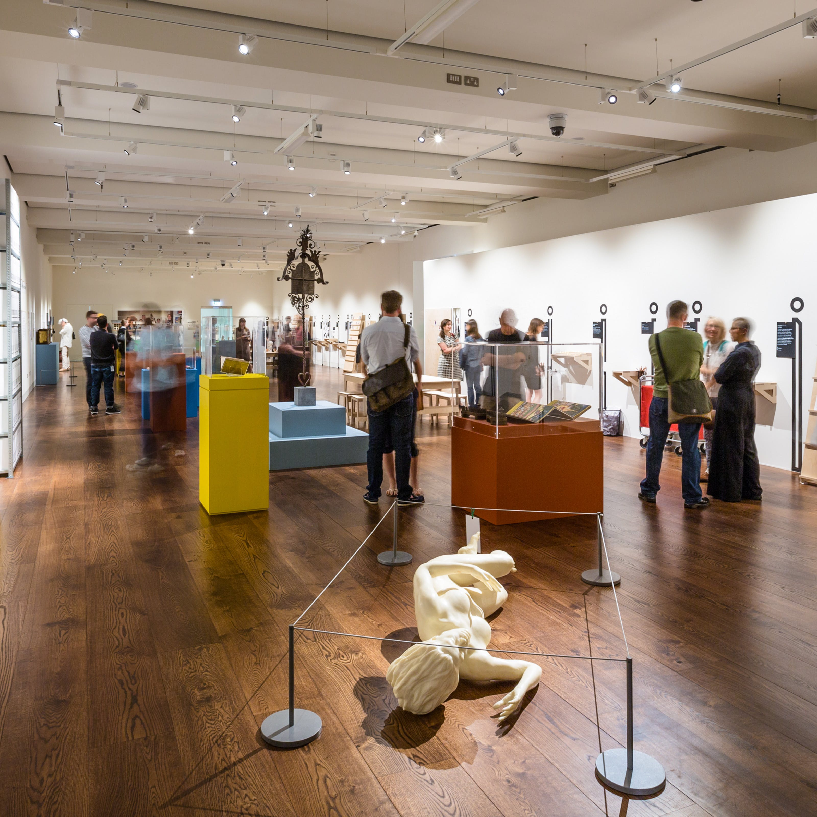 Photograph of the exhibition, An Idiosyncratic A to Z of the Human Condition, showing visitors exploring the space.