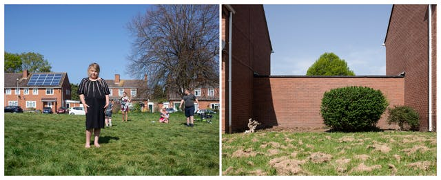 A photographic diptych. The image on the left shows an area of rough grass on which a young girl stands facing camera wearing a black dress and flip-flops. Behind her a woman sits on the grass with a baby and another woman and children stand as though engaged in an activity. Behind them several red brick houses and parked cars can be seen.  The image on the right shows a tall red brick wall running between two red brick houses and an area of rough grass in the foreground on which patches of cut grass have been left and dried. A large round privet hedge, a smaller hedge, and the remaining stump of a hedge are planted in front of the wall.