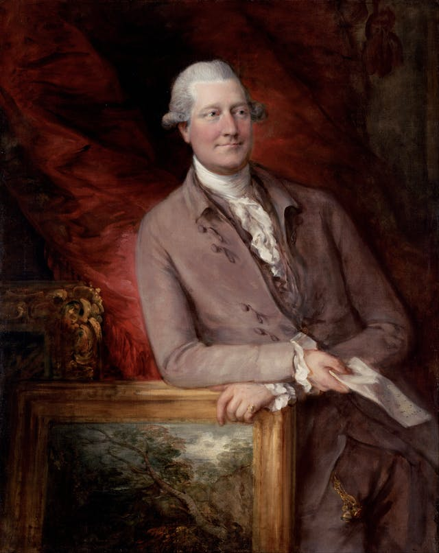 Painting of James Christie.  He is depicted leaning casually on a framed landscape painting.