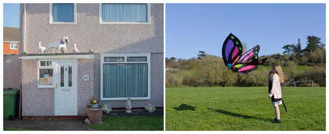 A photographic diptych. The image on the left shows a grey pebbledash house with white PVC door and windows. On top of a porch are three models of white bull terriers with black eye patches. The larger life size bull terrier, wears a purple neckerchief. There are other smaller stone ornaments on the porch roof and in the garden below including water babies or cherubs, as well as a terracotta flowerpot beside the door. The image on the right shows a young girl standing on the right of the image in a playing field with a goal post, a slight hill and trees beyond. The girl stands side on looking out to the left of the image. A short distance in front of her face is a large colourful butterfly kite.  Both the girl and the kite cast shadows on the ground across the grass.
