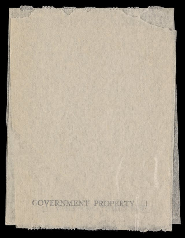 "Photograph of a toilet paper sample sheet, bearing the stamp, ""Government Property"" across the bottom of the sheet."