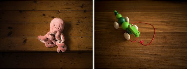 Photographic diptych. The image on the left shows a pink fluffy octopus on a wooden stair case. The image on the right shows a wooden crocodile toy with wheels and a red string resting on a wooden floor.