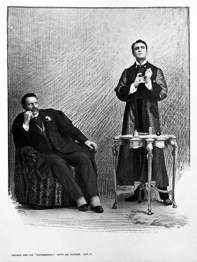 Black and white illustration of two men, one sitting in an armchair, and the other standing and holding a syringe