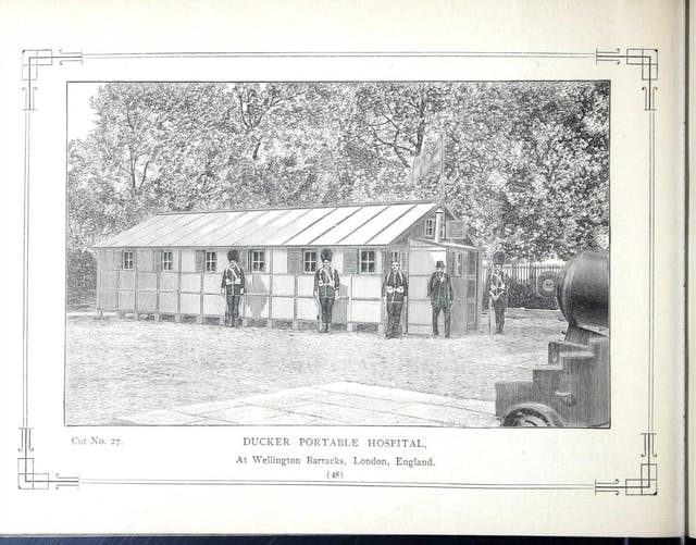 Page from book with full illustration of a wooden hut (hospital) with soldiers standing outside it.