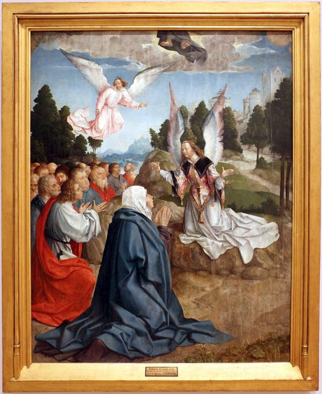 Oil painting depicting a group of kneeling figures accopmanied by two angels. In the sky above them, two feet protrude from the bottom of a robe, represrenting Christ