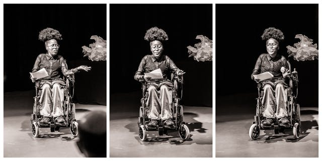 Photographic triptych, black and white with a warm tone. Each image shows the same young woman seated in a wheelchair against a black curtain and lit by a spotlight. She is performing to an audience and holds pieces of paper in her right hand. Her facial expression and gesticulation changes in each image.
