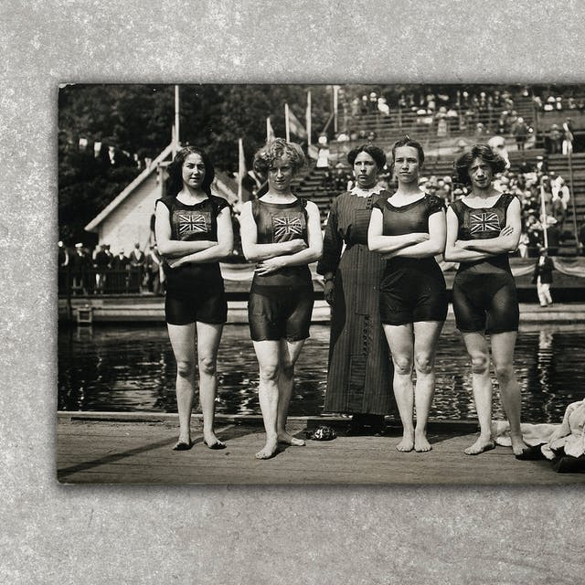 Photograph of a black and white photographic postcard showing the victorious English 400m women