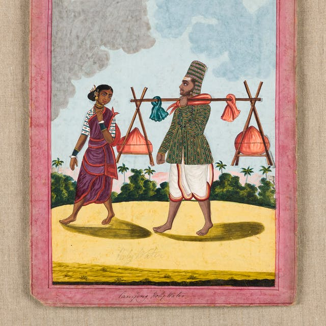 Photograph of a gouache drawing showing a man carrying Holy water with his wife. They are walking across a yellow sand and palm trees and  forest can be seen in the distance. The man has a staff resting on his shoulders. Attached to either end are containers of water. His wife walks beside him. Under the drawing are the words,