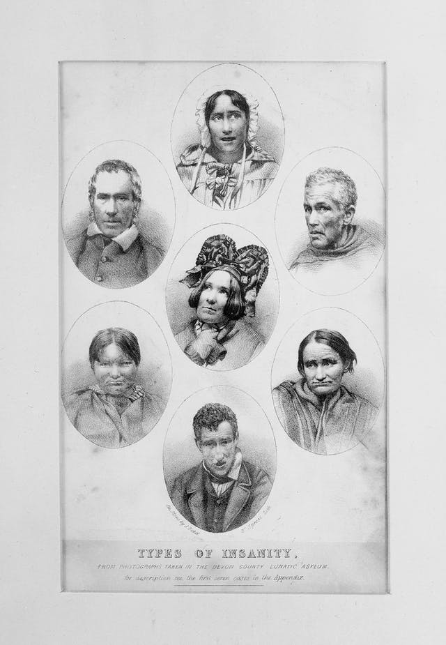 Black and white drawing featuring seven faces in various poses