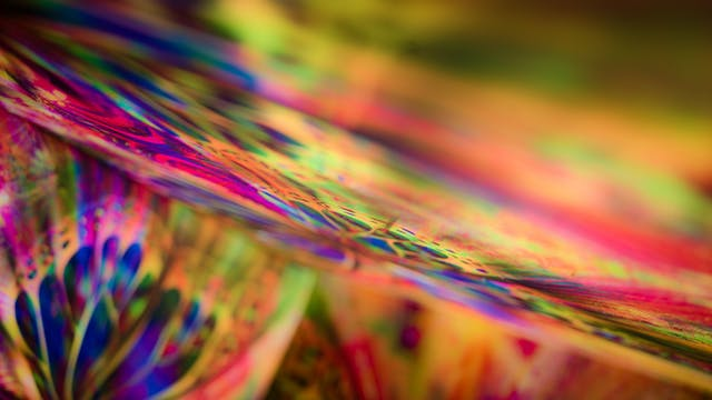Photograph of an abstract colourful pattern with areas out of focus.