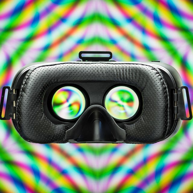 Photograph of a VR headset on a colourful patterned background.