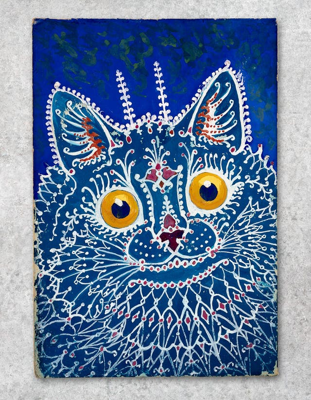 Photograph showing a work of art against a grey concrete textured background. The artwork shows colourful, abstract interpretation of a cat in tones of blue, white and yellow, by Louis Wain. On a blue ground, a turquoise cat, the patterns of its fur being formed by white lines resembling gothic tracery