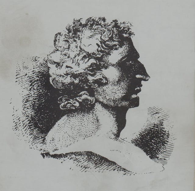 Monochrome etching of the head of Thomas Spence in profile.