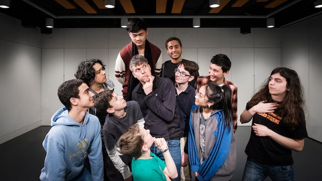 Photograph of ten of the RawMinds Improv Comedy youth group surrounding and looking at science comedian, Simon Watt who is centre frame.