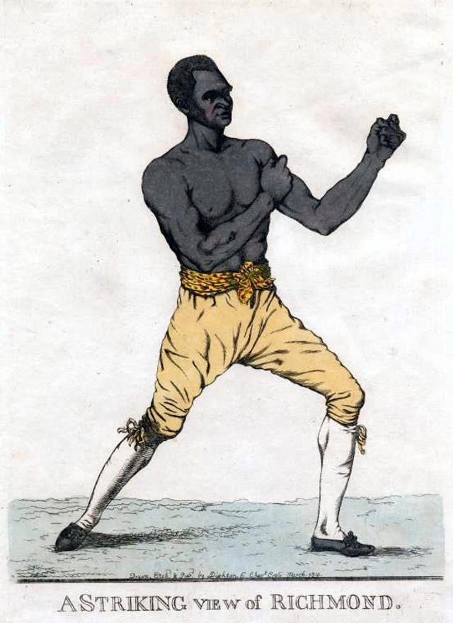 Hand coloured etching of the boxer Bill Richmond.  He is standing at three-quarters profile with fists raised.  Text below reads