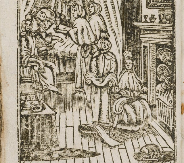Black and white etching showing a midwife holding a baby on her lap in front of the fire. A lady lies in a bed behind, recovering from having just given birth.