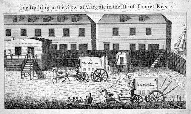 Drawing of horsedrawn bathing carts for swimmers to change in on an enclosed area of beach at Margate in the Isle of Thanet, Kent.