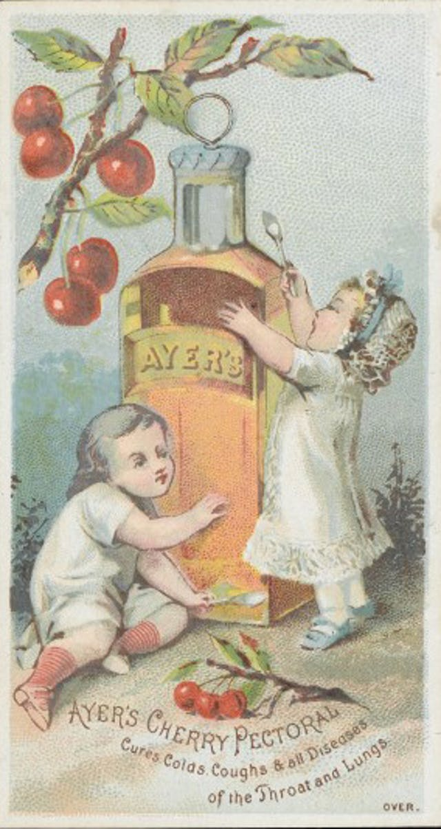 Small children playing with giant bottle of Ayer