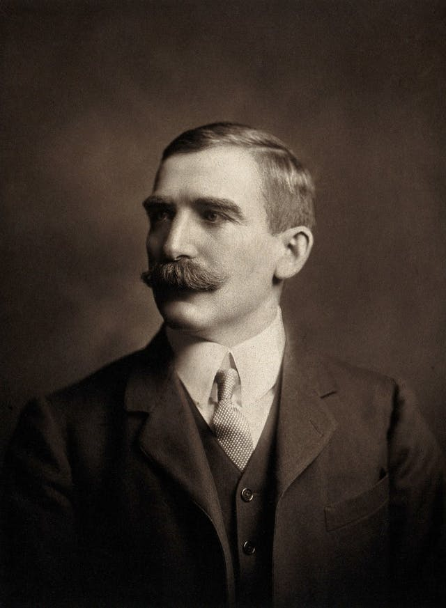 Black and white photo portrait of man with moustache and suit