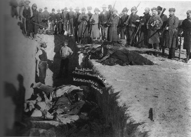 Burial of the dead after the Wounded Knee Massacre
