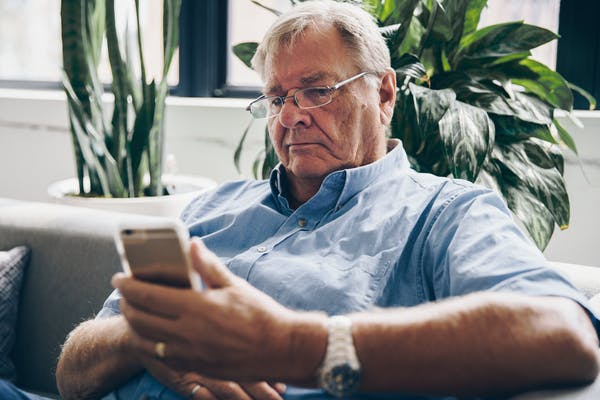Older man with smart phone