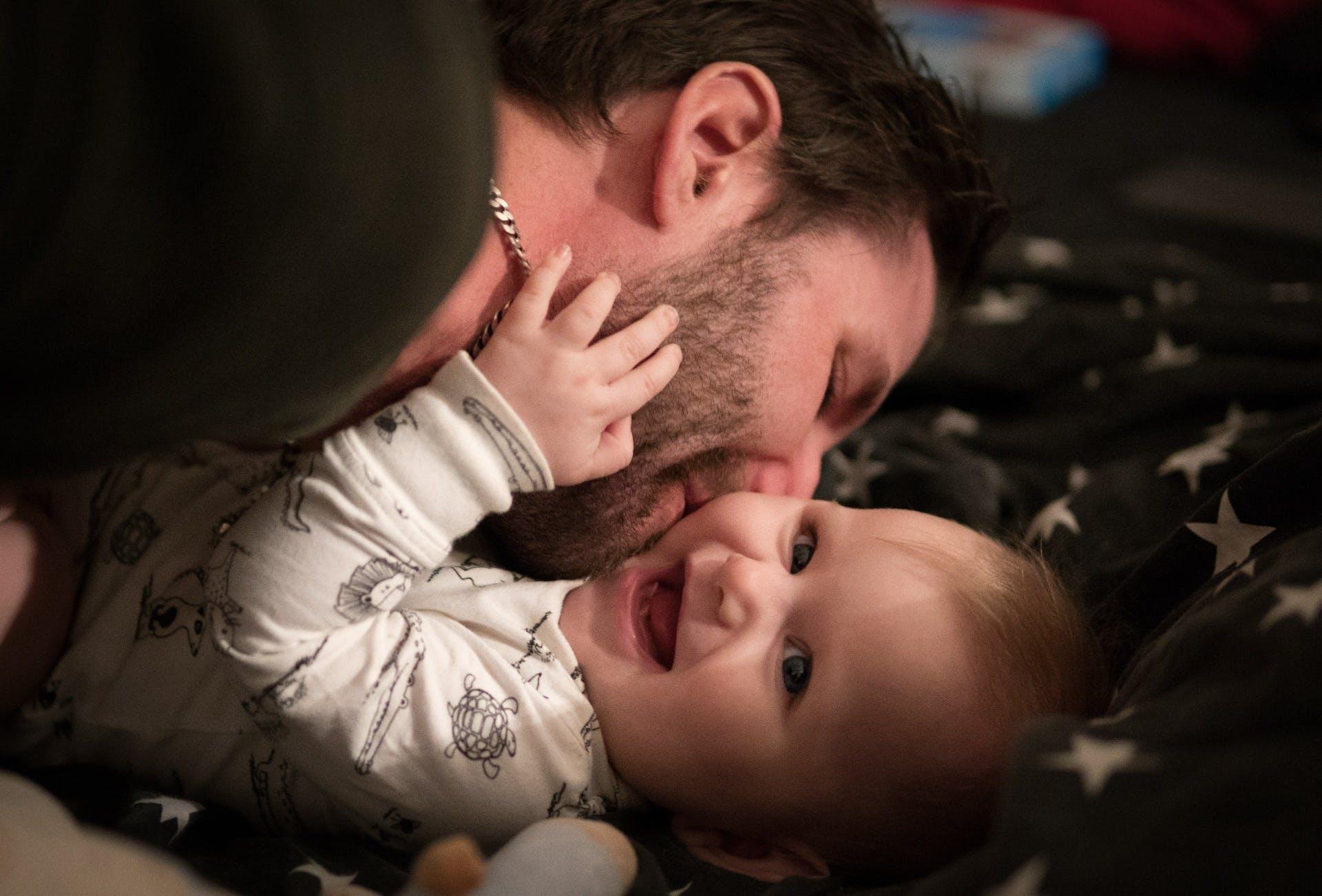 Man hugging baby
