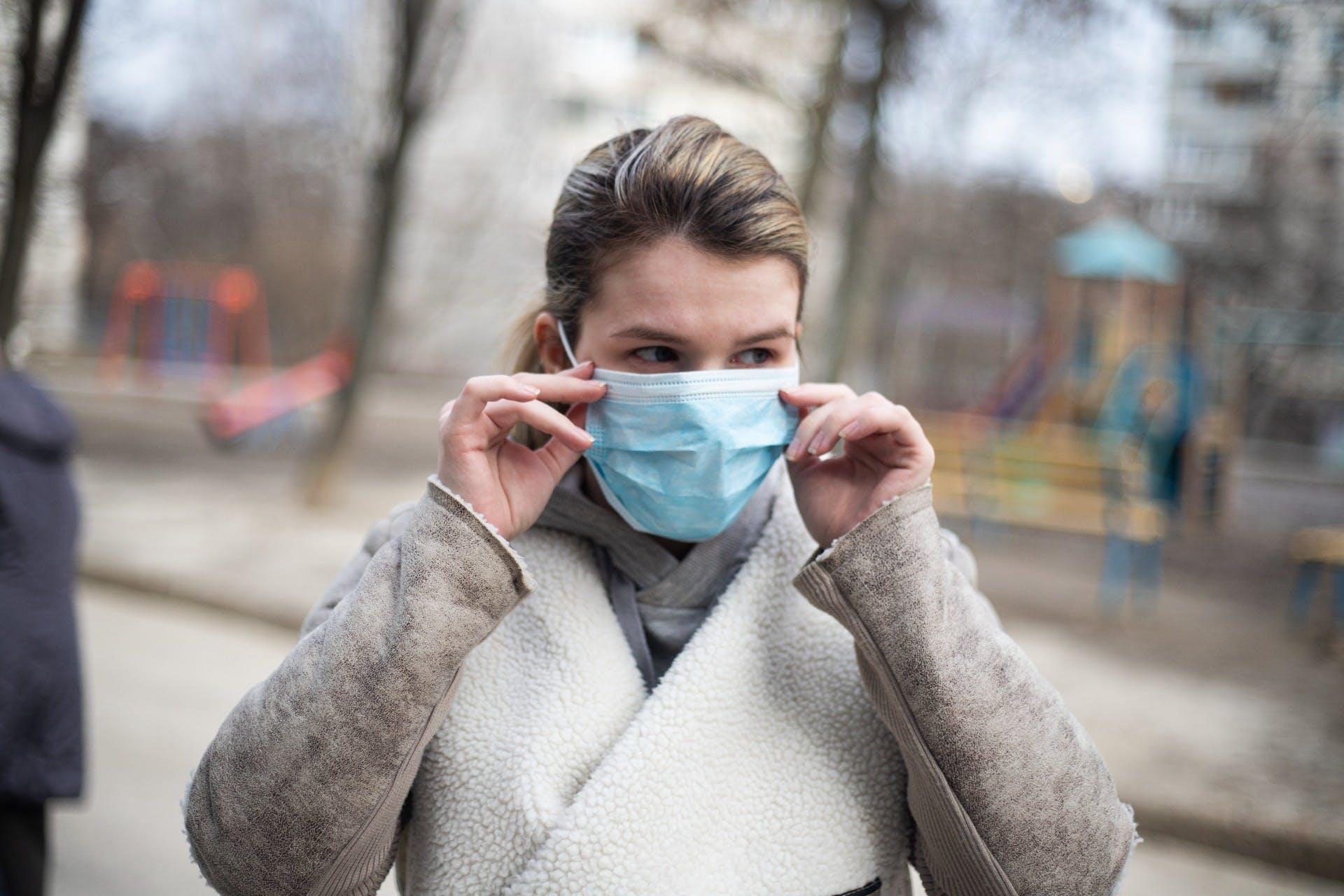 Woman fixing face mask