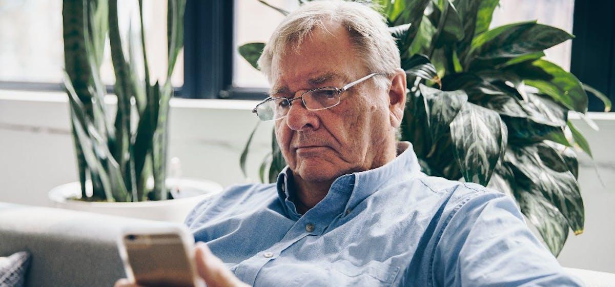 Man using smartphone.