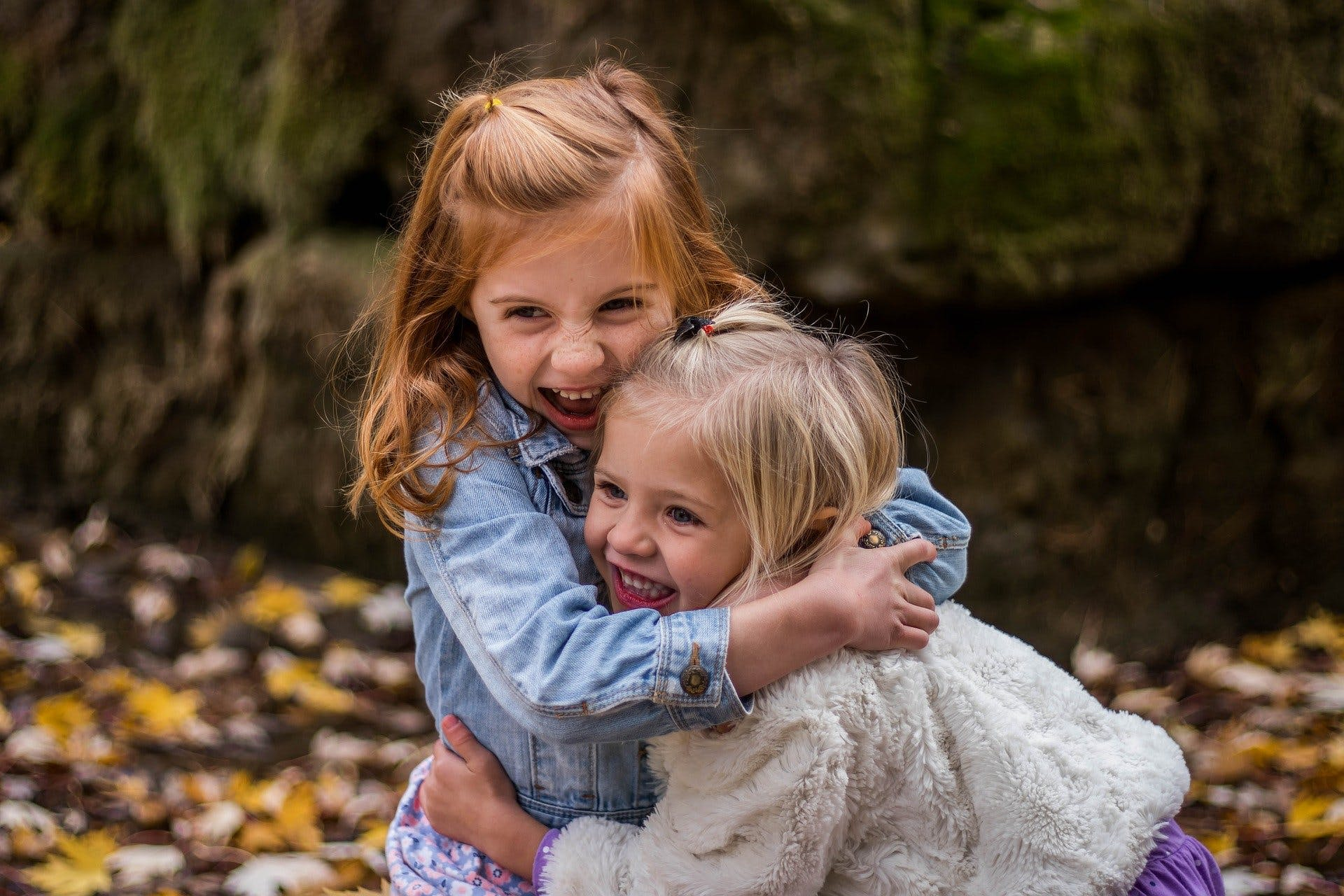 two young grls playing together.