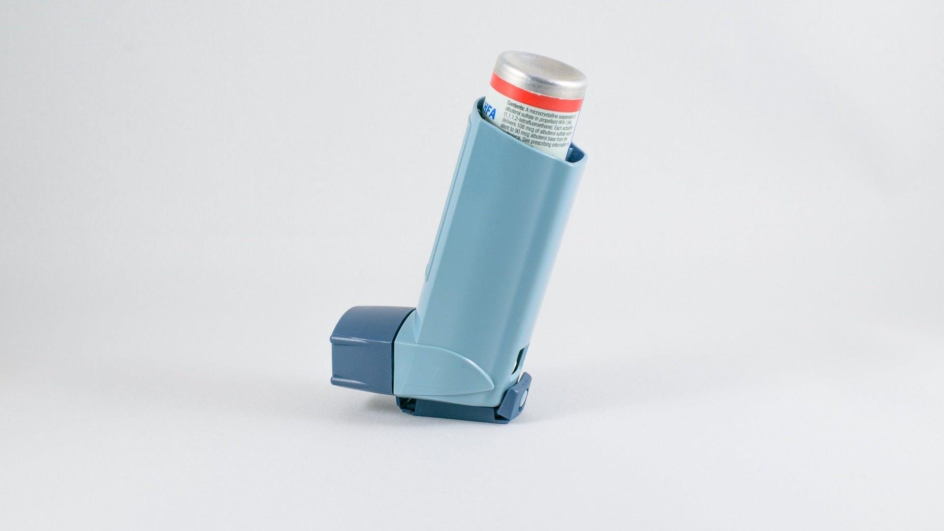 A blue asthma inhaler.