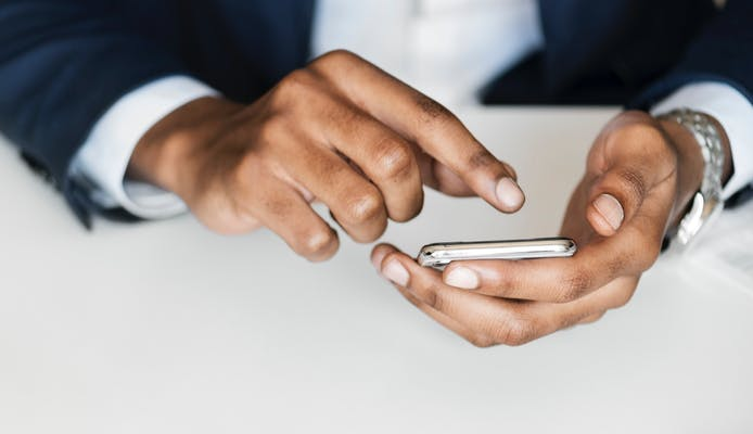 Close up of a man using a phone