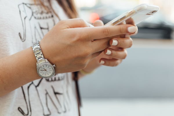 Close up of woman's hands using a mobile phone